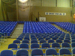 396 tiered seats plus flat floor