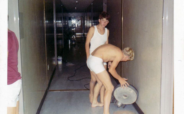Ross McGowan (RIP) and Neil McGrath cleaning the hallway on 'Panic Night' C 1973