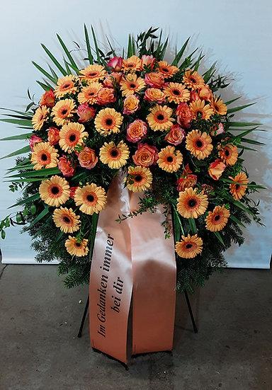 Kranz mit orangenen Gerbera & Rosen