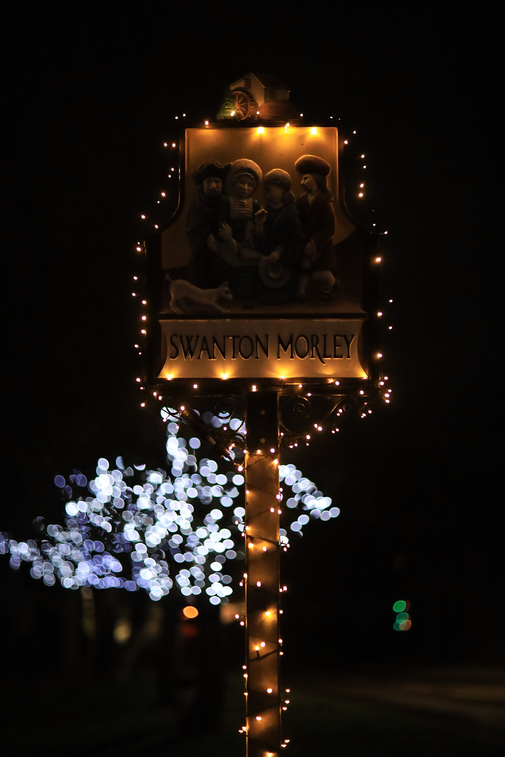 Swanton Morley Village Sign lit with Christmas lights
