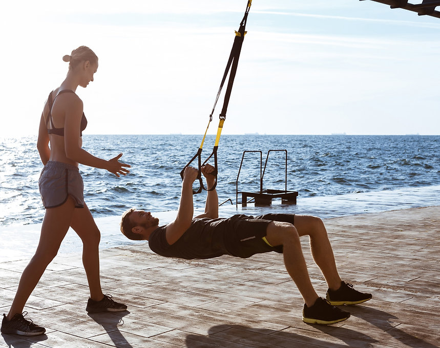 young-sportive-people-training-with-trx-