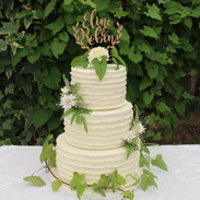 Buttercream finish with fresh edible foliage and flowers