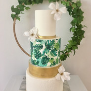 Stencil detail with gold lustre, edible printed wrap and handmade sugar flowers