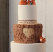 Wood effect fondant with handmade highland cows