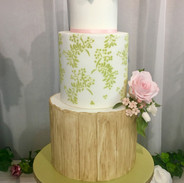Bark effect tier with stencil detail and handmade sugar flowers