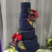 Navy blue teamed with sugar flowers in jewel colours really does make a statement