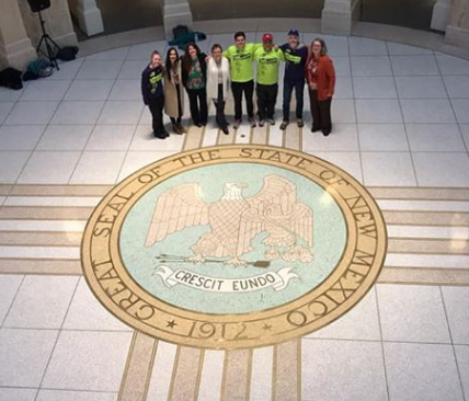Members of the NMANP with runners from The Run at the State Capitol Building in Santa Fe