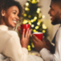 Christmas time. Afro couple talking and