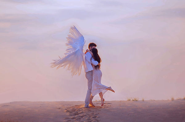 positive Happy Girl and angel hugging. man in white suit creative wings Princess long hair