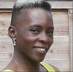 A profile picture of Yinka. Black woman with short hair.