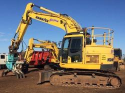 Komatsu PC228 excavator with rotating tree grab