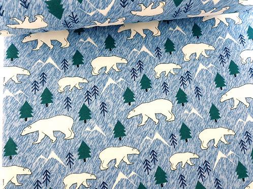 Polar bear on blue mountain