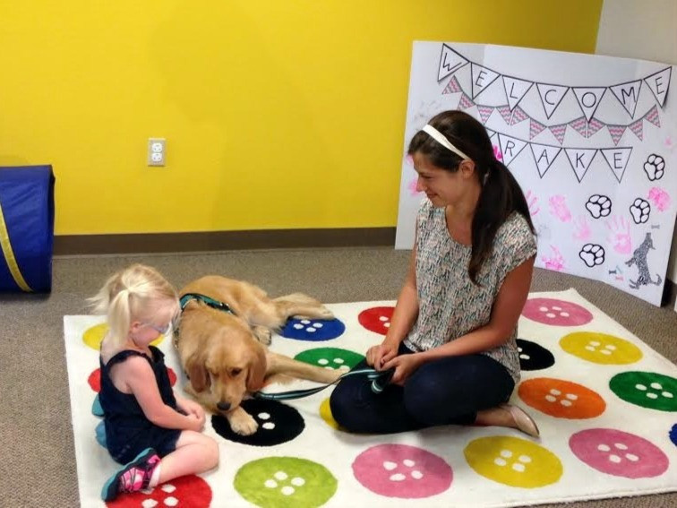 Facility dog Drake at work with a child