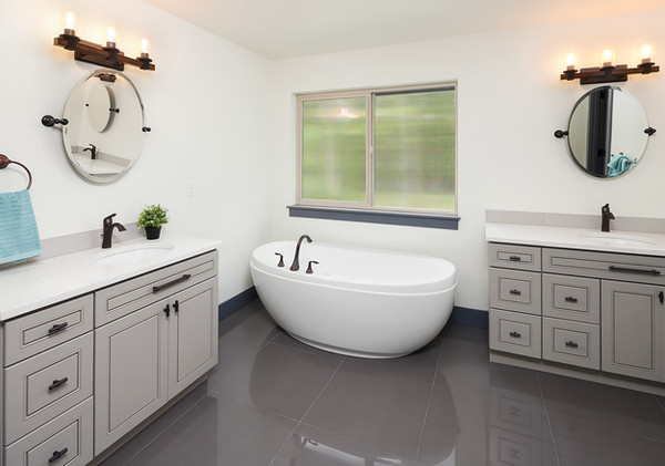 A fresh take on His and Her vanity sets featuring drop in basins and gunmetal black faucets.