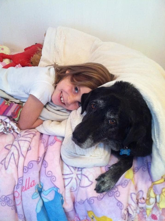 Julia and Daisy cuddled in bed.JPG