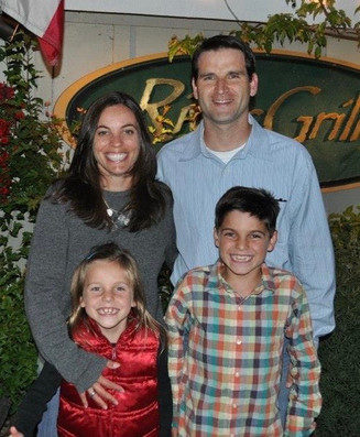 Family photo in front of River Grill.JPG