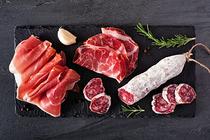 Meat appetizer platter with sausage, and