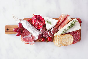 Serving board of assorted meats, cheeses