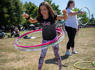 girl playing with hula hoops at a circus workshop  Wellington New Zealand