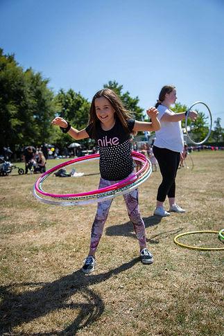 girl playing with hula hoops outside Wellington New Zealand