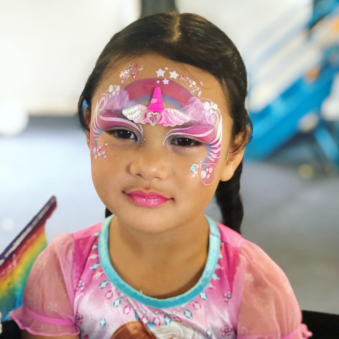 Pink unicorn princess face paint