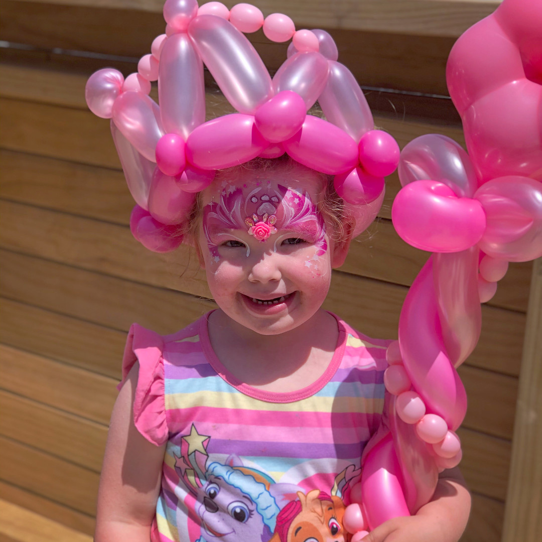 Pink princess face paint and balloons