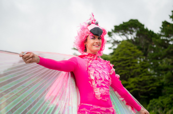 bright pink silt wslker Flamingo circus performer