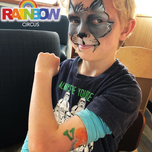 wolf face painting and glitter tattoo on the Ferry Bluebridge Wellington New Zealand