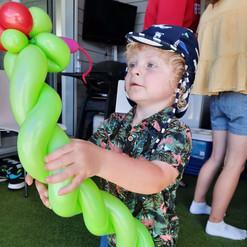 Boy with snake balloon