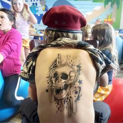 airbrush tattoo skull back piece