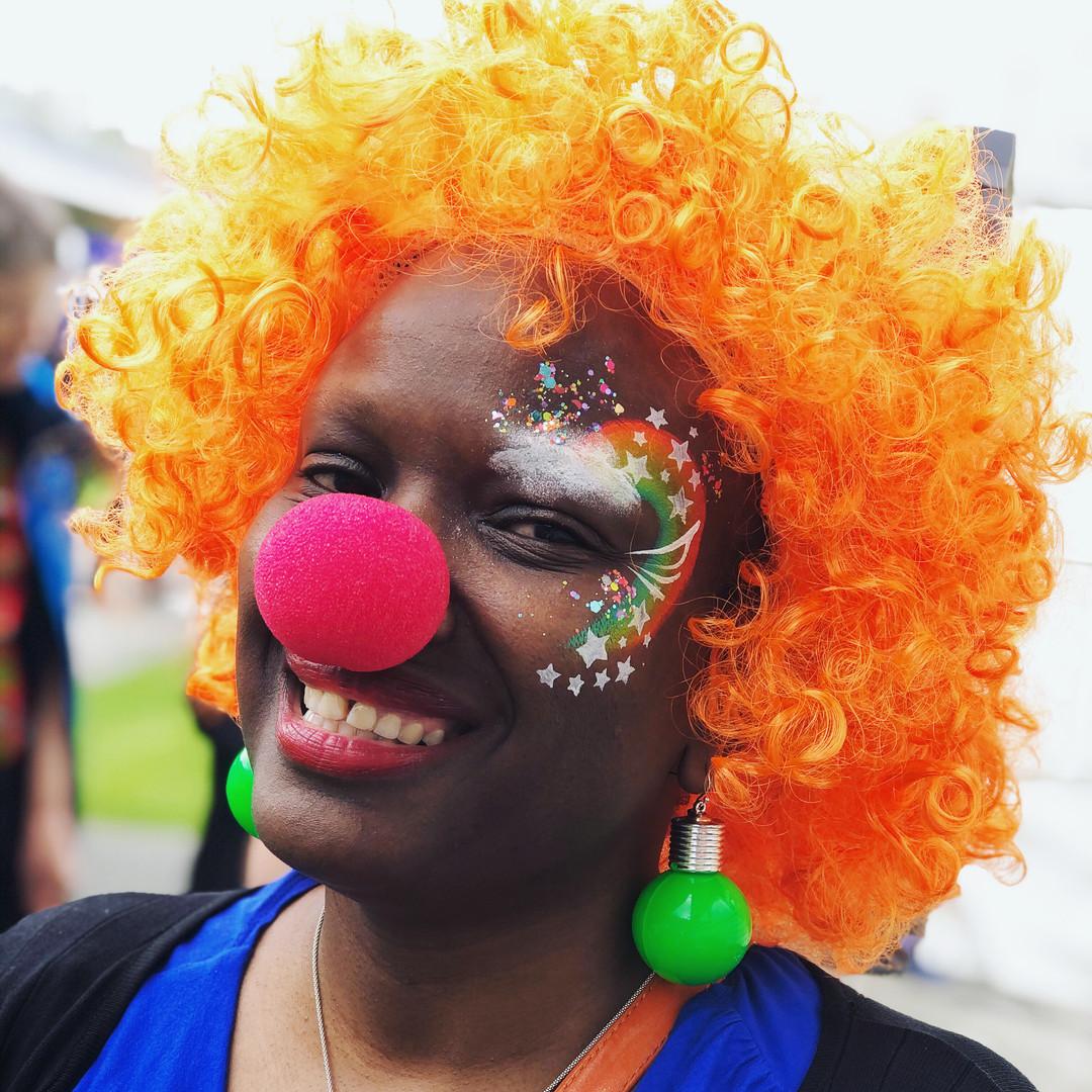 Rainbow cloud clown face paint
