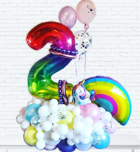 rainbow uncicorn balloon centrepiece marquee