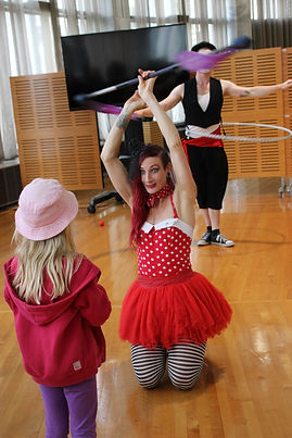 girl watching a circus performer  Wellington New Zealand