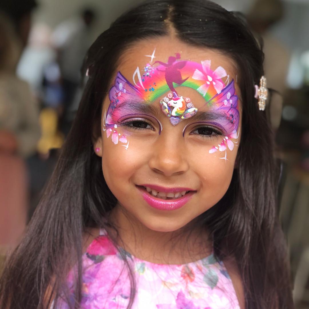 Rainbow fairy face paint