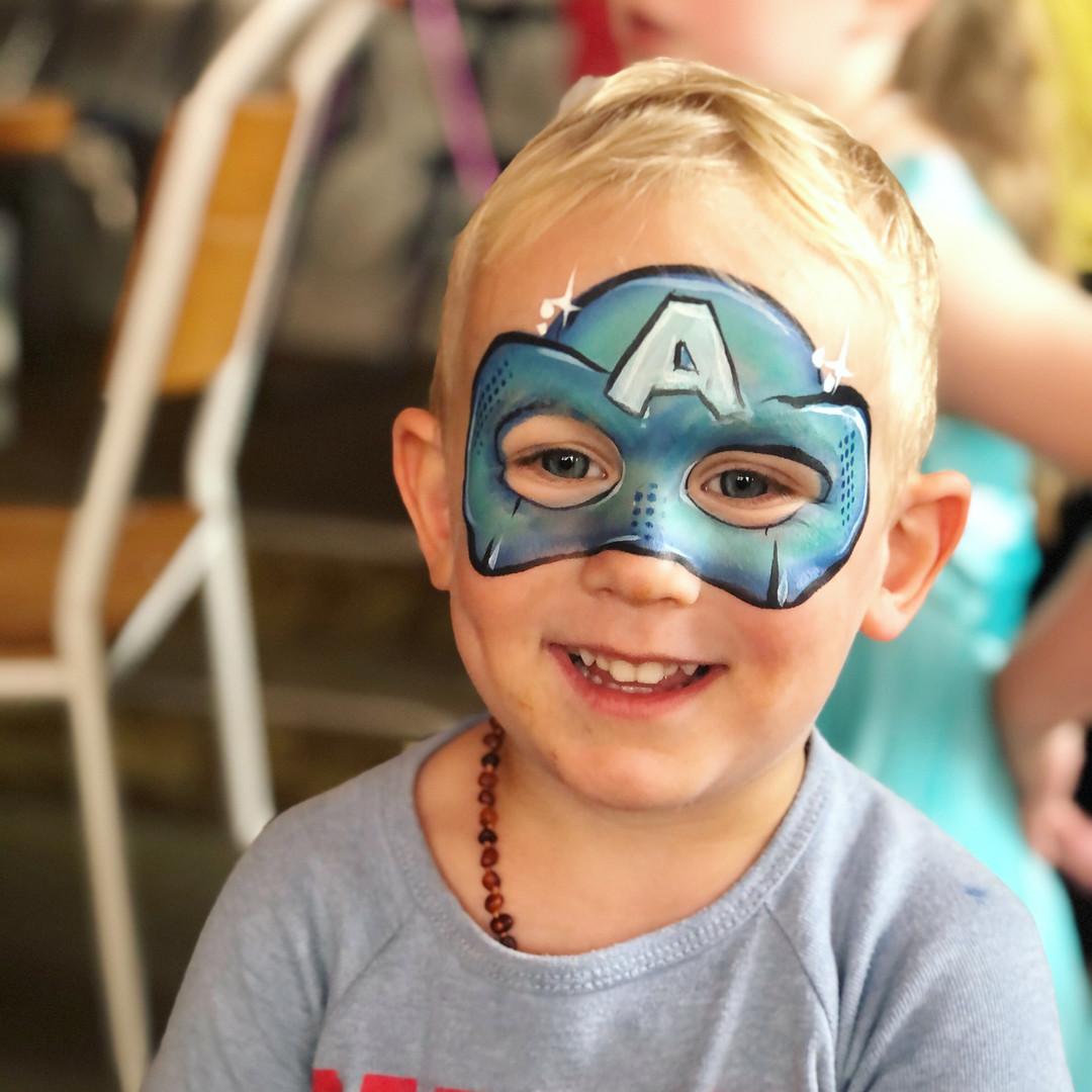 Captain America face paint on boy