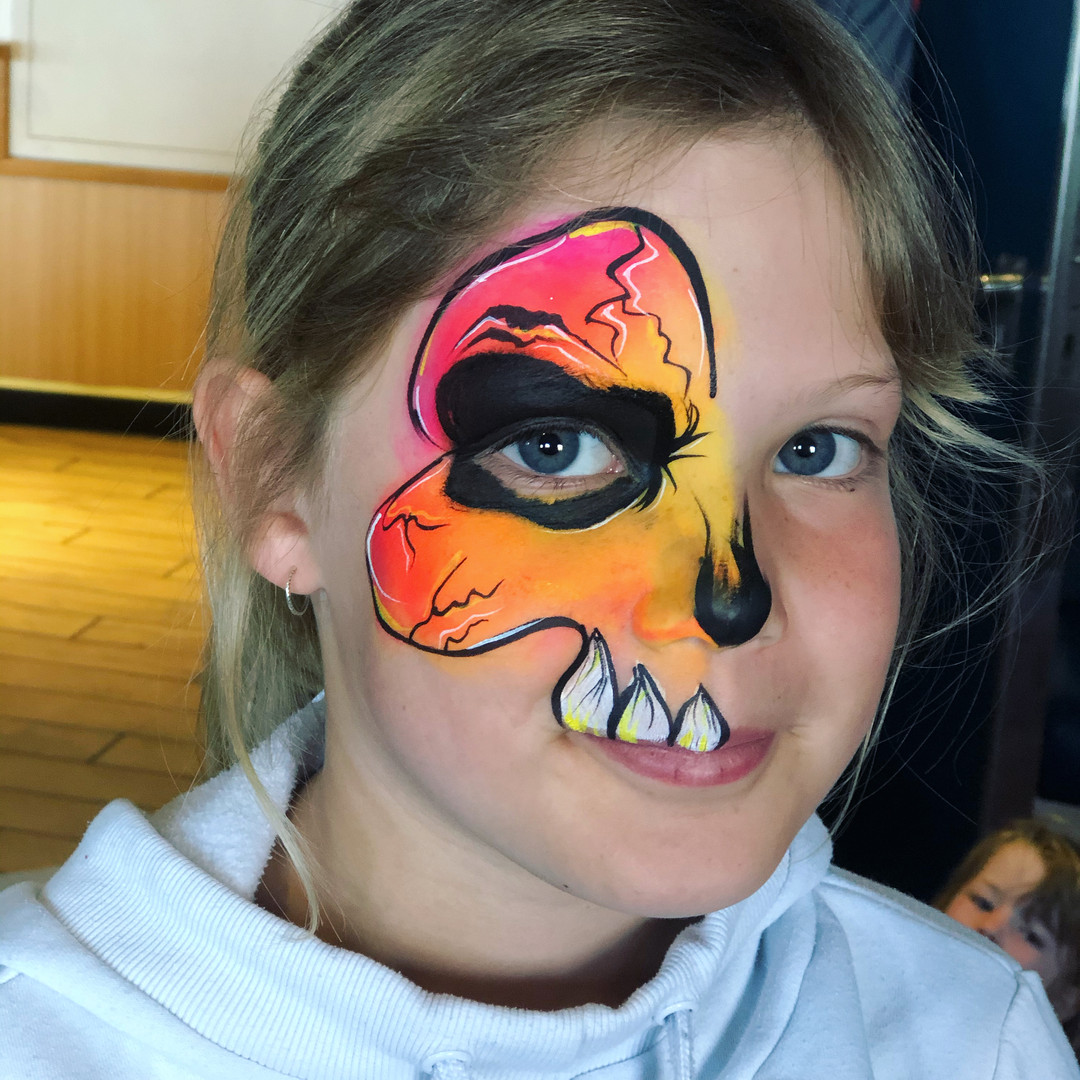 Neon orange skull face paint