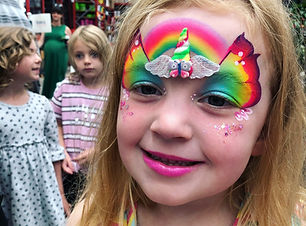 girl with butterfly face painting and unicorn horn  Wellington New Zealand