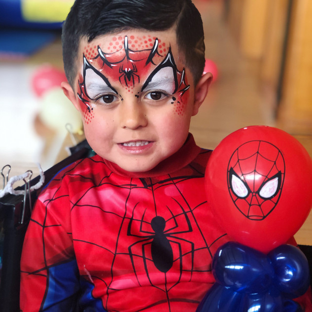 Spiderman face paint and balloon twisting