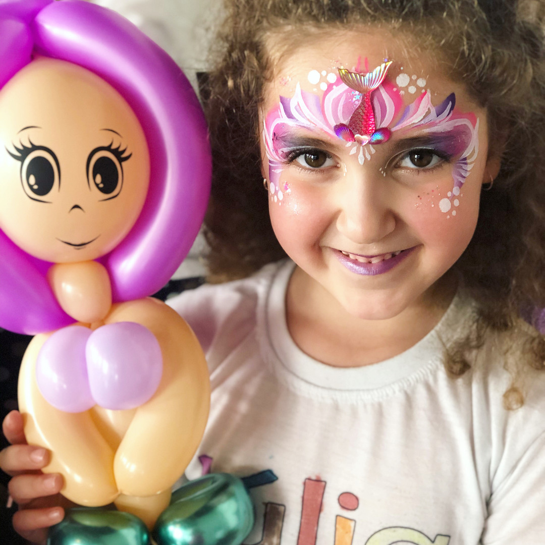 Mermaid face paint and balloon