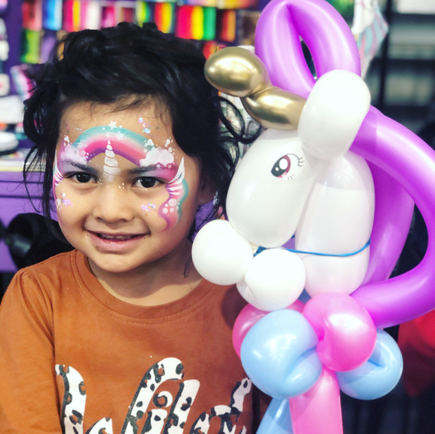 unicorn face paint and balloon