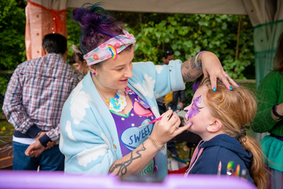 Cherry face painting at an event