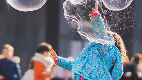 girl playing with giant bubbles Wellington New Zealand