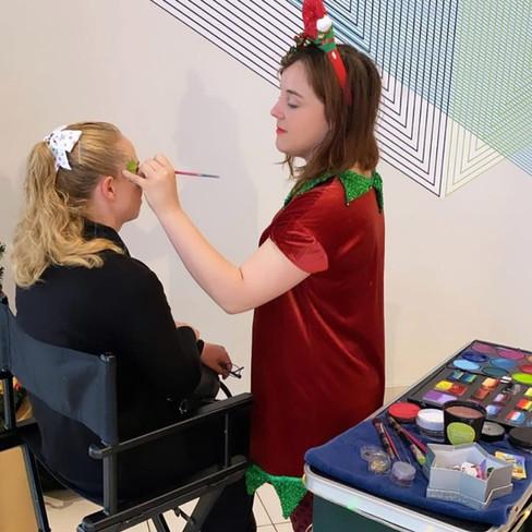 Raimbow Elf Face painter at an event