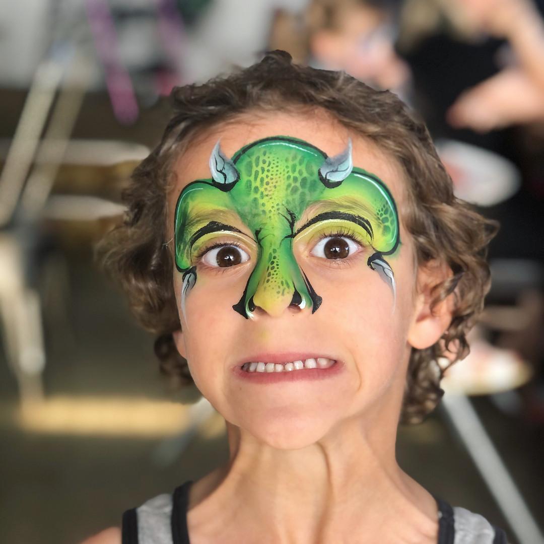 green dinosaur face pain