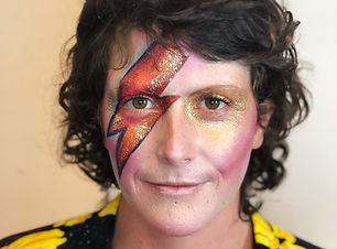 woman with David Bowie lightning bolt makeup  Wellington New Zealand