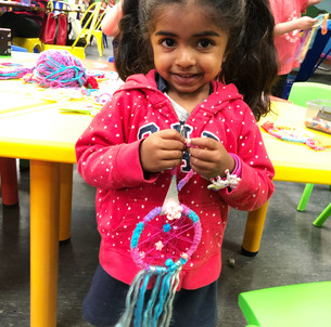 Girl with unicorn Dreamcatcher Craft Workshop DIY Kids Wellington New Zealand