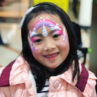 pink and putple unicorn face paint