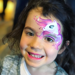 Pink unicorn face paint