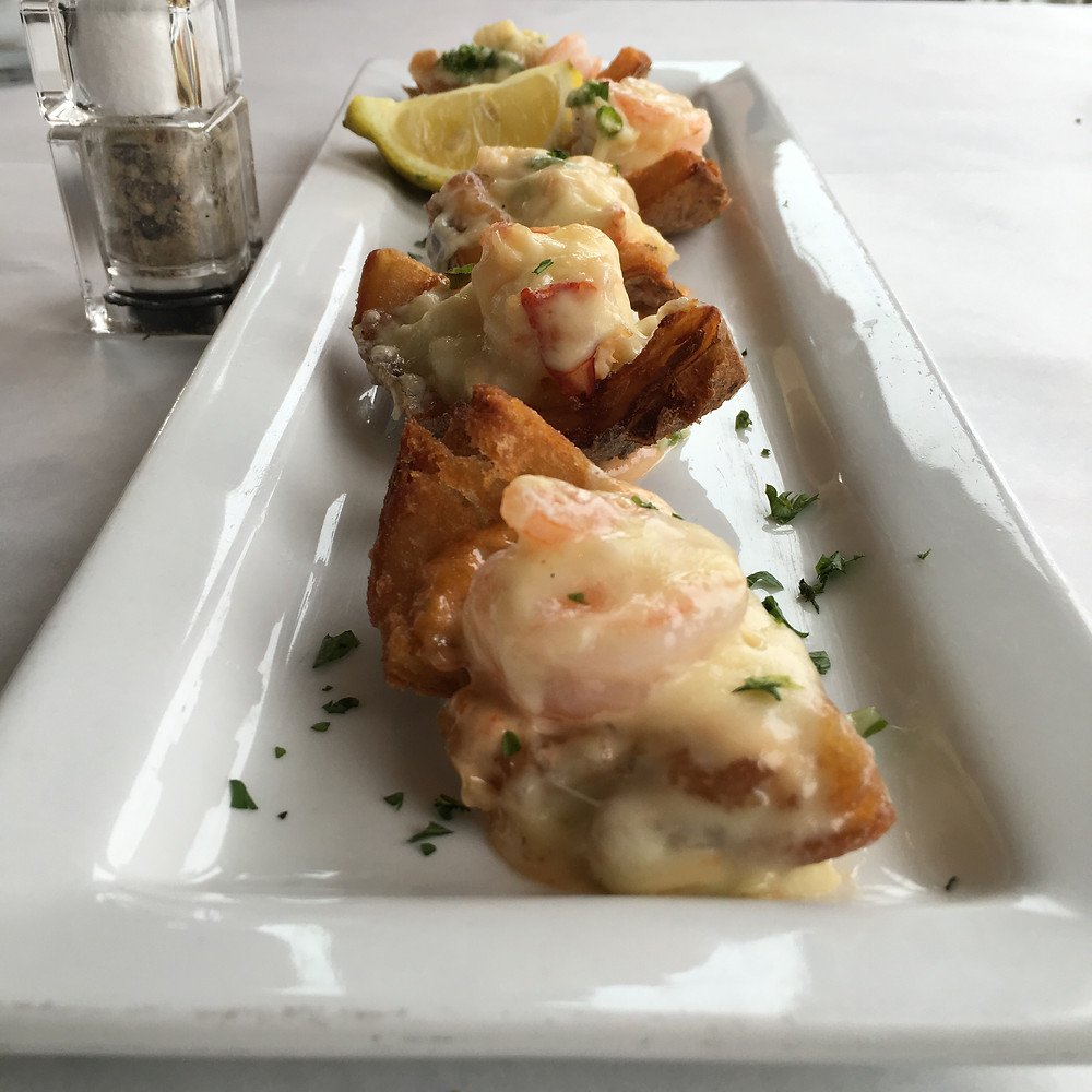 Seafood Stuffed Potato Skins - lobster, shrimp, and crab in a special sauce; topped with Swiss cheese and scallions.