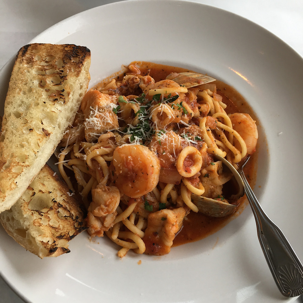 Seafood Fra Diavolo - shrimp, calamari, clams & monkfish in a spicy marinara tossed with linguine